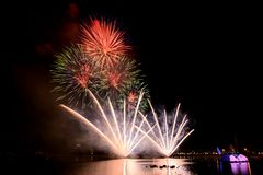 Bright and colorful fireworks against a black night sky.Firework Royalty Free Stock Images