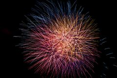 A bright and colorful fireworks celebration stock photography
