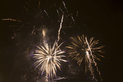 Bright colorful fireworks on new years eve in Ostrava, Czech republic against cloudy sky.  Royalty Free Stock Images