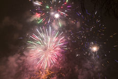Bright colorful fireworks on new years eve in Ostrava, Czech republic against cloudy sky Stock Photo