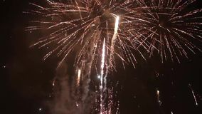 Bright colorful fireworks on new years eve in Ostrava, Czech republic against cloudy sky, no audio stock video