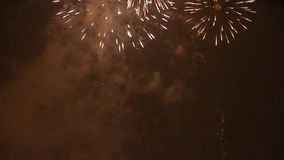 Bright colorful fireworks on new years eve in Ostrava, Czech republic against cloudy sky, no audio stock video footage