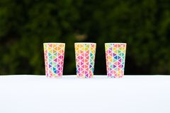 Bright colorful glasses, dishes for a picnic, summer glasses. Copy space stock image