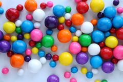 Bubble Gumballs. Bright and colorful gumballs in different sizes full frame background royalty free stock photos