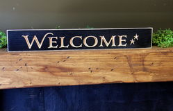 Bright, and colorful handcrafted sign that reads the word `welcome` Royalty Free Stock Image