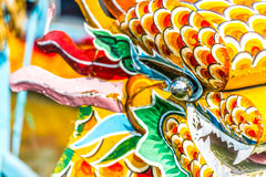 Multicolored face of vietnamese dragon. Royalty Free Stock Photography