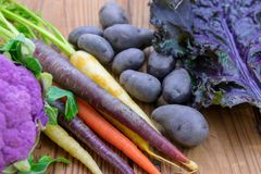 Bright colorful healthy purple vegetables. On a rustic wood background Stock Photo