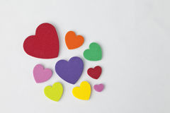 Bright colorful hearts on white background.  Variety of color and sizes. Royalty Free Stock Photos