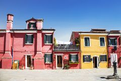 Bright colorful houses on Burano island on the edge of the Venetian lagoon. Venice Royalty Free Stock Images