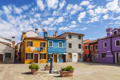 Bright colorful houses on Burano island on the edge of the Venetian lagoon. Venice Stock Images
