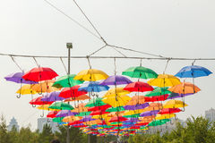 Bright colorful hundreds of umbrellas floating above the street. The city of Astana, Republic of Kazakhstan Royalty Free Stock Image