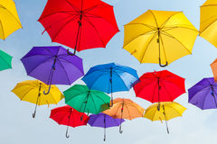 Bright colorful hundreds of umbrellas floating above the street Stock Photo