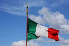 Bright colorful italian flag on flagstaff Royalty Free Stock Photo