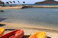 Bright and colorful kayaks in tropical setting Royalty Free Stock Photo