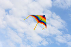 Bright, colorful kite on the background of the summer sky.  Stock Photography