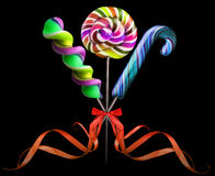 Bright colorful lollipop over black background Royalty Free Stock Photography