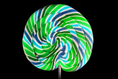 Bright colorful lollipop over black background Stock Photos