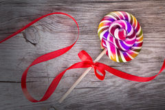 Bright colorful lollipop on wooden table Royalty Free Stock Photography