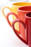 Bright colorful mugs Stock Photography