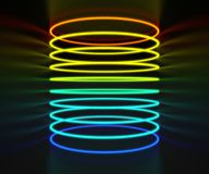 Bright colorful neon light rings in dark room. Royalty Free Stock Photos