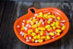 Happy Halloween Candy Corn. A bright, colorful orange bowl of Halloween candy corn stock photography