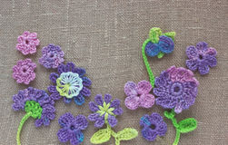 Bright colorful original crochet handmade background with flowers and leaves. Nice cotton homemade irish crochet elements for Spri Stock Photo