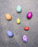 Bright, colorful painted eggs for Easter, laid out in a row border place for text   granit rustic background top view close up Stock Image