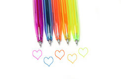 Bright colorful pens and abstract hearts Stock Images