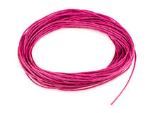 Bright colorful pink woven twine in looped circle isolated on wh Royalty Free Stock Image