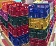 Bright colorful plastic boxes. Colored plastic texture from a row of boxes. Abstract, freight royalty free stock images