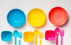 Bright colorful plastic disposable tableware on white background Stock Photography