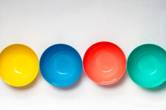 Bright colorful plastic disposable tableware on white background Stock Photos
