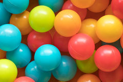 Bright and Colorful plastic toy balls, ball pit, close up stock photos