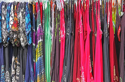 Bright Colorful Print Womens Clothing Sun Dresses. Colorful print women's clothing sun dresses on hangers green red blue Stock Images
