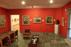 Bright and colorful room, with masterpieces done by local artists,Ogunquit Museum of American Art,Maine,2016. Beautiful scene with several colorful masterpieces Royalty Free Stock Photography