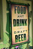 Bright and colorful sign advertising food,drink and draft beer Stock Photo