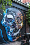 Bright colorful skull graffiti. Bright colorful skull graffiti painted by an artist on the street of London Royalty Free Stock Photography