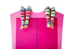 Bright colorful socks on a closet. Isolated on white Royalty Free Stock Image