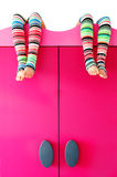 Bright colorful socks on a closet. Isolated on white Stock Photo