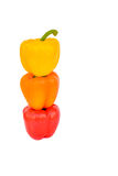 Bright colorful stacked bell peppers Stock Images