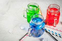 Bright colorful summer drinks with ice Royalty Free Stock Images