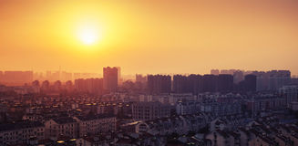 Bright colorful sunrise over big city panorama. Vintage toned Stock Photography