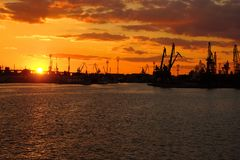 Bright Colorful Sunset at Cargo Sea Port Stock Photography