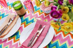 Bright colorful table setting with chevron tablecoth Stock Image