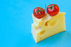 Cheese and cherry tomatoes Royalty Free Stock Images
