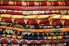 Bright, colorful Turkish fabrics, bedspreads and kerchiefs with different oriental patterns. The texture of the textile or fabric, Royalty Free Stock Images