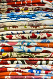 Bright, colorful Turkish fabrics, bedspreads and kerchiefs with different oriental patterns. The texture of the textile or fabric, Royalty Free Stock Photos