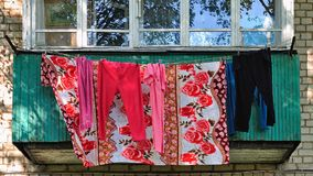 Bright colorful underwear dries after washing on the balcony. Of an apartment building for low-income people, Yaroslavl, Russia Stock Images