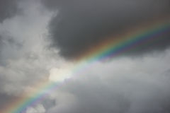 Bright colorful wide  rainbow after the storm in the gray sky. Stock Photography