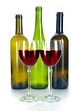 Bright colorful wine bottles and glass.Still-life on a white background Royalty Free Stock Image